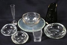 8 PIECES of Erickson and other air trapped bubble glass lot includes: (1) Erickson large clear ash tray (2) Small Erickson clear ashtrays (1) footed bowl with air trapped bubble pattern  (1) Erickson smoke controlled bubble vase with slanted top rim. (1) bubble vase square top and bottom with paperweight bottom (1) controlled bubble bud vase (1) air trapped bubble bowl (Erickson?), clear with faint opalescence