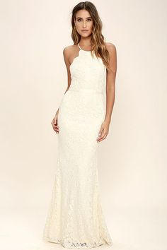 You've reached the pinnacle of high society when you have an occasion to wear the Zenith Cream Lace Maxi Dress! A darted, scalloped bodice rises to form a high neckline with adjustable straps that crisscross at back. Grosgrain ribbon sash tops a flaring mermaid maxi skirt. Hidden back zipper and clasp.