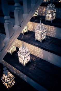 These lanterns are elegent and beautiful! A great way to add a little atmosphere in a room with a staircase. #whitelanterns #weddingdecor