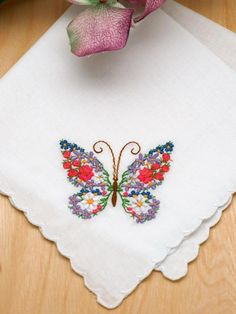 Set of 3 Butterfly Floral Embroidered Ladies Handkerchiefs If you are planning a butterfly theme wedding, these handkerchiefs would make great favors for your guests. Butterflies are a popular with many brides, as they symbolize new beginnings.      These handkerchiefs are very lovely as they have scallop edging and a beautiful butterfly design in one corner. The butterfly design is made extra special because the butterfly is comprised of bright and colorful flowers.       Each handkerchief…