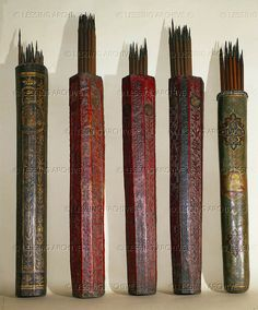Venetian quivers, four wood, one leather, with arrows.   Museo Storico Navale, Venice, Italy