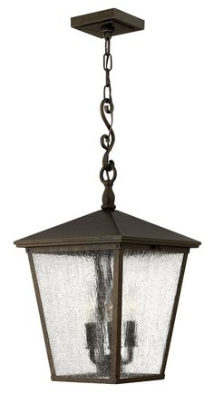 Regency Bronze finish and special seedy glass panels lend just the right level of detail to this outdoor hanging light, from the refined Trellis collection. Cast aluminim construction. Supplied w/ 6' of wire and 5' of chain.