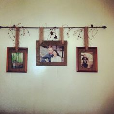 Curtain rod, some ribbon or burlap, picture frames. Easy. Rustic!