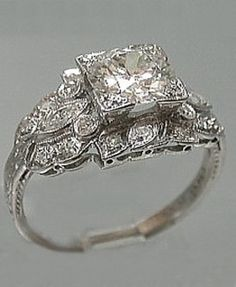 Platinum Art Deco Filigree Ring, 1920s. OMG this looks darn close to the one I fell in love with recently. And it was at a  MARKET!!!! with a collector!