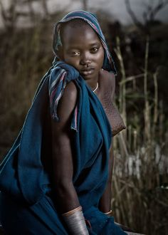 Lower Omo Region, Ethiopia. She is from the Suri tribe.