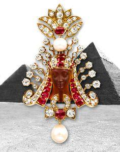 Designer G. Paulding Farnham for Tiffany & Co, 1800.  Burma ruby, natural pearl, diamond and gold headdress surrounding a carved carnelian cameo of an Egyptian pharaoh
