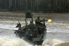 SWWCs from Special Boat Team-22 operating a Special Operations Craft-Riverine (SOC-R) during a training exercise. Note the firepower present on the boat. When coming in for a hot extraction of SEALs, the SWWCs will pour huge amounts of suppressive fire into the shoreline and treelines surrounding it in order to keep any heads down. SOC-Rs can carry an array of GAU-17/A 7.62mm miniguns, .50 cal MSHB machine guns and M60, M240 7.62mm belt-fed machine guns and even 40mm automatic grenade…
