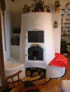 this wood stove fireplace. Rocket Heater, Rocket Stoves, Cob Building, Building A House, Earth Bag Homes, Four A Pizza, Outdoor Oven, Cooking Stove, Natural Homes