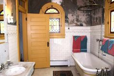 Intact 1900 bathroom in 1870 Italianate house, Boonesville, MO. Upper walls are original mural in need of restoration.