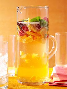 Try this ultra-fruity sparkling sangria at your next outdoor party! More of our favorite cooling cocktail recipes: http://www.bhg.com/recipes/drinks/wine-cocktails/summer-cocktail-recipes/?socsrc=bhgpin062314sparklinggoldensangria&page=4