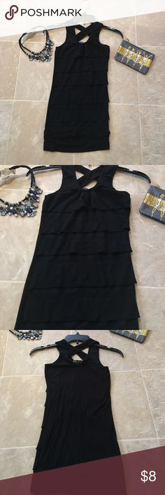 XS Black Ruffled Tank 💕 Condition- nwot  Size - XS ( Juniors ) Color- black Style- Ruffled form fitting tank Brand- Miley Cyrus Smoke free pet free home!! Ships within 2 business days!  Bundle with 2 or more listings and save 25% through march Miley Cyrus Tops Tank Tops