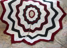 http://www.ravelry.com/patterns/library/free-smoothfoxs-christmas-tree-skirt