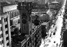View looking south on Broadway at 1st Street. The old Times Building (3rd Times Bldg.) with its ornate castle-like tower stands guard while the new Times Building on First and Spring is still under construction. The new building was completed in 1935.