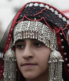 A festive headgear from Sanaa, Yemen.  The picture is recent (2010s), but the fashion goes back to the 19th century.