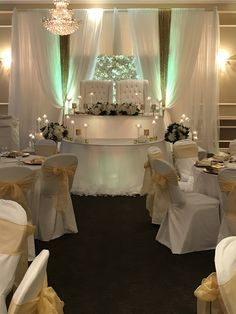 Florals and candles make this romantic all white w a touch a gold. Decor by FCC Decor.