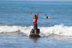 Learning to surf will put a smile on anybody's face. #learntosurf #surflesson #goodtimes  sunsetsurfdominical.com