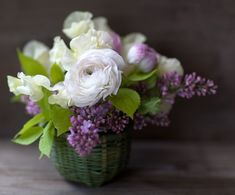 So, so pretty!  Ranunculus and lilacs for centerpiece |  www.journal.florali.com.