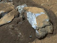 """Blue Martian Rock June 2013 The Mast Camera (Mastcam) on NASA's Mars rover Curiosity showed researchers interesting internal color in this rock called """"Sutton_Inlier,"""" which was broken by the rover driving over it."""