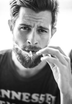 His cigarette ruins him but his beard is great!