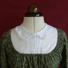 Regency Chemisette with Tucks, Lace Collar and Crosswheel Dorset Buttons in Cotton Mousse by Historika. https://www.etsy.com/listing/75474530/regency-chemisette-with-tucks-lace?ref=shop_home_active_2