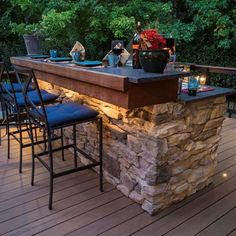 A beautiful deck and porch with an outdoor kitchen and double fireplace. The porch featured a motorized screen, TV and stereo system. Fixed screening is the ezescreen system with super screen. Wall light fixtures are gas lamps. All railing, decking and lighting is made by TimberTech