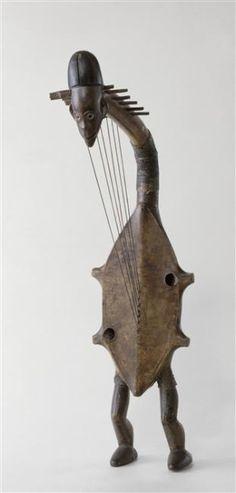 curiositycontained:  (via alainrichertvia goodmemoryvia heracliteanfire) Harpe à six cordes Kundi (via Réunion des musées nationaux)