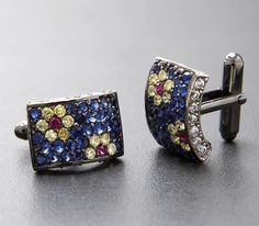 Uniquely designed, these Stanley Lewis men's cufflinks are a handmade masterpiece. The two tone rhodium plating allows the white and topaz cubic zirconium, and blue and ruby synthetic stones to radiate. Each stone in these silver cufflinks has been h See THESE beautiful photos of ruby necklaces & more. Check THIS Out & the latest Videos, Tips & Trends in Photography @ http://www.photopinns.com