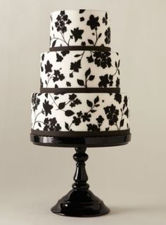 A white dress with a black floral overlay gave Liz Shim food for thought. The result? A stylized showpiece featuring flowers painted with lustrous black dust. Fondant cake with hand-painted flowers, Eat Cake Be Merry, New York; Black White Cakes, Black And White Wedding Cake, White Wedding Cakes, Unique Wedding Cakes, Beautiful Wedding Cakes, Gorgeous Cakes, Wedding Desserts, Pretty Cakes, Amazing Cakes
