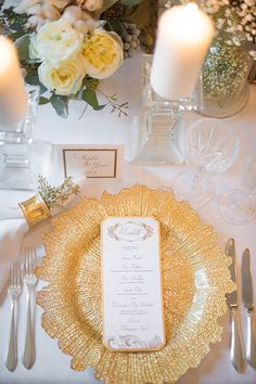 A formal wedding place setting with a gold charger | Brides.com