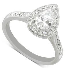 … 18ct White Gold .59ct Pear Cut Diamond Halo Ring