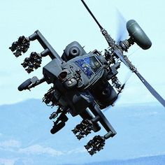 The Boeing AH-64 Apache is a four-blade, twin-engine attack helicopter with a tailwheel-type landing gear arrangement, and a tandem cockpit for a two-man crew.