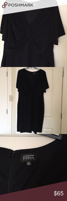 Adrianna Papell black dress Beautiful faux wrap dress. Fluttery short sleeves and wrap neckline lends a really nice hourglass shape. This is s gorgeous dress! Excellent condition, worn once. From Nordstrom's, by Adrianna Papell. Adrianna Papell Dresses