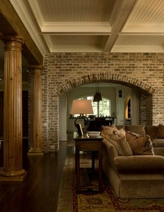 Living Room with Brick Arch, Natural Fluted Columns and Painted Wood Beams Brick Archway, Brick Columns, Fluted Columns, Interior Columns, Brick Interior, Interior Design, Brick Accent Walls, Exposed Brick Walls, Exposed Beams