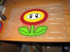 Mario Fire Flower perler beads by ndbigdi on deviantART