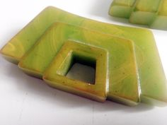 A pair beautiful Art Deco drawer pulls formed in bakelite. Green bakelite features swirls of dark yellow that blend to a yellow-green color with a