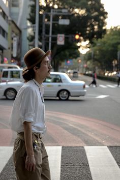 Street Style of Tokyo: Wearing COMOLI Shirt & Pants, HESCHUNG Shoes, COMESANDGOES Hat, OLIVER PEOPLES Glasses, and HERMES Bracelet
