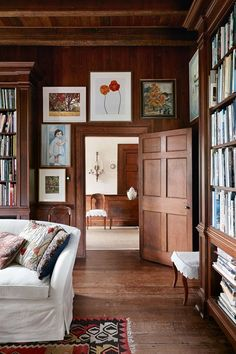 A traditional dark wood panelled hall with framed art - halls of any size or style: Victorian to modern.