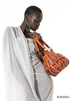 modafrica225: Bag design by Alain Niava (workshop : Alleen's Abidjan Ivory Coast)  Model : Djela  (via afrodesiacworldwide)