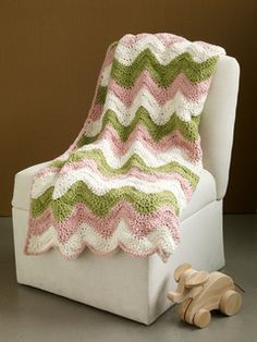 This snuggly ripple afghan is super soft in Nature's Choice Organic Cotton. (Lion Brand Yarn)