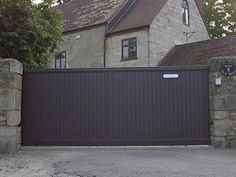 Add a solid powered gate to the parking area from the alley -- currently fenced off. Driveway Design, Driveway Landscaping, Driveway Gate, Fence Gate, Outdoor Spaces, Outdoor Living, Outdoor Decor, Electric Gates, Sliding Gate