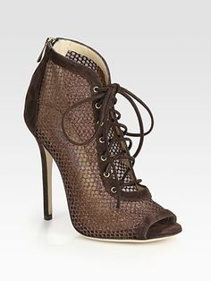 Jimmy Choo Tegan Lace-Up Suede and Glitter-Coated Mesh Peep Toe Ankle Boots Lace-up suede style with a back zipper, peep toe and glittery mesh sides.
