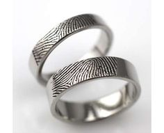 if i ever get married... neat idea, fingerprint wedding bands, how personal is that!?!