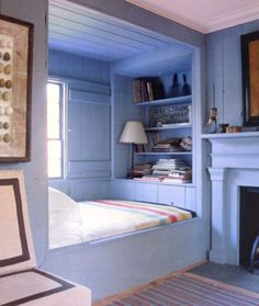 """Built-in bunk with bookcase and sliding window """"shutter"""""""