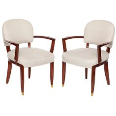 Set of Four Mahogany Armchairs by Jules Leleu | From a unique collection of antique and modern armchairs at http://www.1stdibs.com/furniture/seating/armchairs/