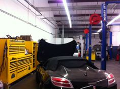 Pictures of cars and trucks in the shop