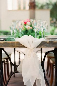 From flowing tulle and long ribbons, this romantic table runner is great for intimate sweetheart tables. | See more trending table runner themes here: http://www.mywedding.com/articles/9-trending-table-runners-for-weddings/