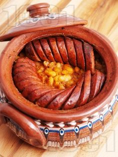 Beans and sausage in a clay pot