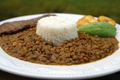 Arroz con menestra or lentil stew with rice  http://laylita.com/recipes/2008/01/11/arroz-con-menestra-lentil-stew-with-rice/
