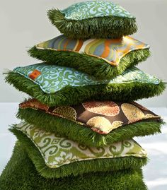 Faux grass on one side, fabric on the other....LOVE this for outdoor seating!