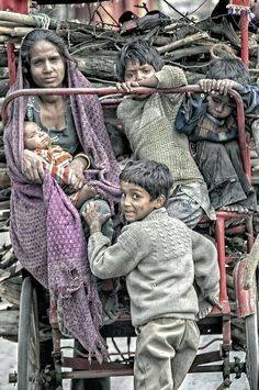 they seem to be carrying wood for CREMATION or for their own abode Loha Pul Delhi Kids Around The World, We Are The World, People Of The World, Poverty Photography, Mundo Cruel, Real Life Heros, World Poverty, World Problems, Poor Children